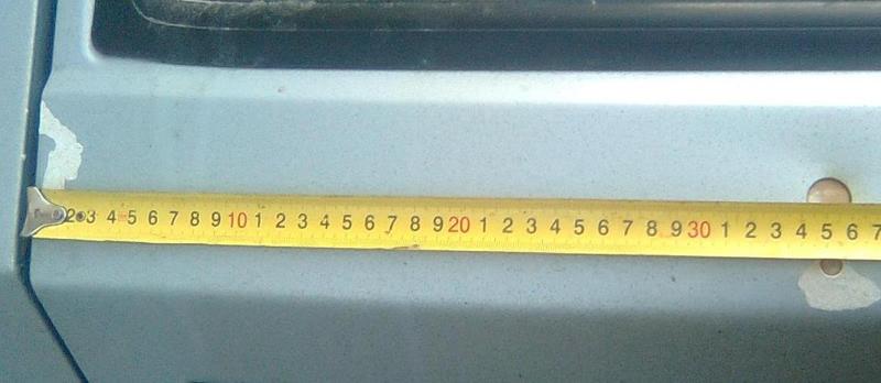 Расположение отверстий для крепления спойлера слева ВАЗ-2114